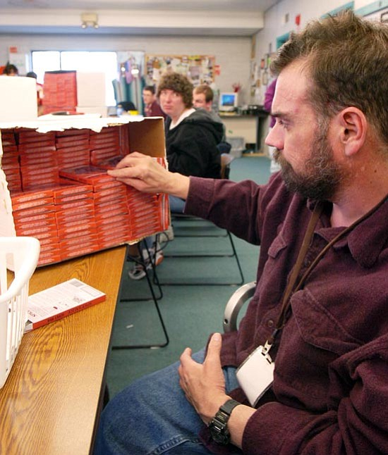 The Daily Courier/Jo. L. Keener<br /><br /><!-- 1upcrlf2 -->Yavapai Exceptional Industries! employee Jim Lincoln packages Spice and Slice seasoning in a box. YEI! pays the employees by either performance or by the piece.