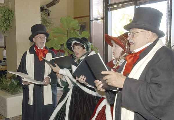 The Daily Courier/Jo.L.Keener A Caroling Company singers Rick Wilson, Darlene Stolle, Helen Isdal and Jerry Leboda performed Saturday at the Prescott Resort.