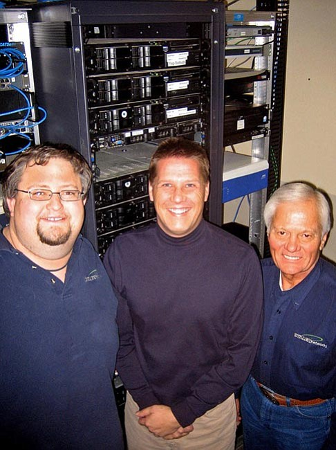 The Daily Courier/Jason Soifer From left: Network Administrator Robert Clark, Systems Manager Alan Sean and Chief Executive Officer Dino Bulleri stand in front of a server at Bulleri Networks' Prescott office.
