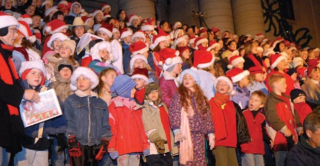 The Daily Courier/Les Stukenberg Students from around the tri-city area sing Christmas songs on the Yavapai County Courthouse steps in front of the crowd of thousands during the annual lighting ceremony.