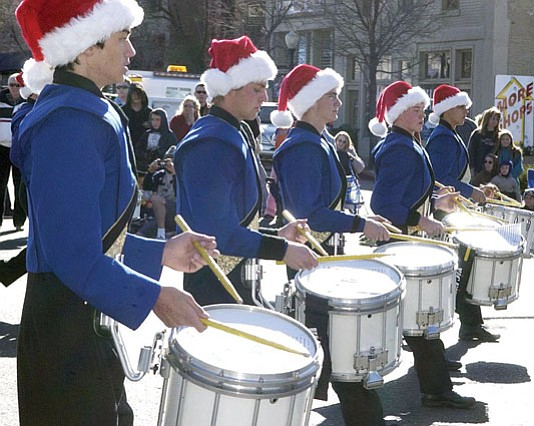 COURTESY  A drumline marches in the 2006 Christmas parade.