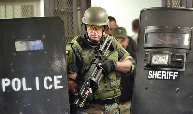 The Daily Courier/Les Stukenberg Members of the Yavapai County Sheriff and Prescott SWAT (tactical response teams) practiced different tactical  situations in the YCSO jail in Prescott Thursday.