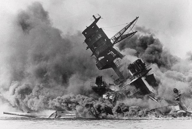 The Associated Press/file The battleship USS Arizona belches smoke as it topples over into the sea during a Japanese surprise attack on Pearl Harbor, Hawaii, on Dec. 7, 1941. The ship sank with more than 80 percent of its 1,500-man crew, including Rear Admiral Isaac C. Kidd.