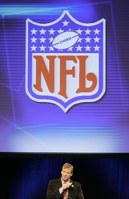The Associated Press/<br>Alan Diaz<br>NFL Commissioner Roger Goodell is watching his league wage battle between its own network and the cable companies.