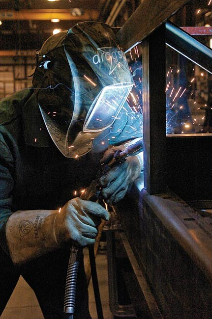 The Daily Courier/Matt Hinshaw Matt Benyi welds together part of a conveyor at Superior Industries in Prescott Valley on Thursday afternoon.  Benyi has been a welder for Superior Industries for five weeks and considers his job a good start to his career.