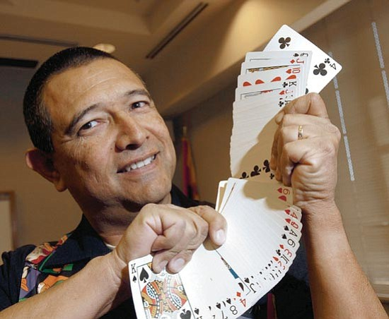The Daily Courier/Jo. L. Keener<br> Magician Eddie Siller displays a fanned deck of cards Thursday as he prepares for a show. Siller is a veteran Prescott police officer with nine years on the department.