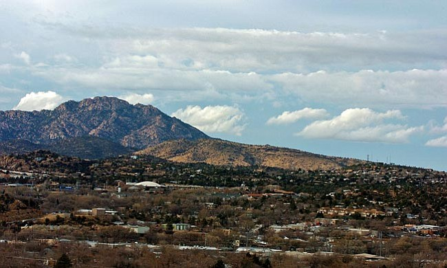 The Daily Courier/Matt Hinshaw<br> Clouds begin to move in over Prescott on Friday afternoon.  The National Weather Service predicts significant moisture for the tri-city area over the weekend.