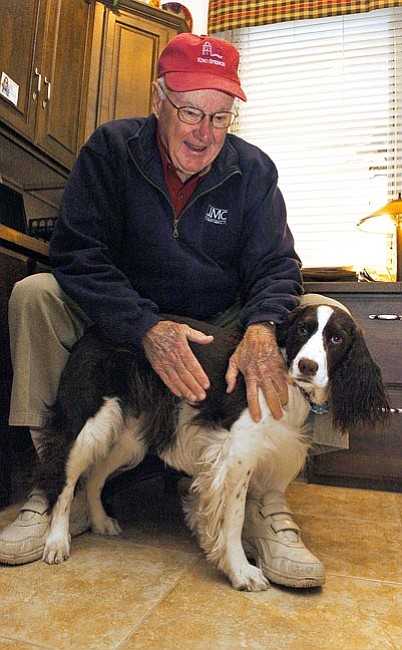 The Daily Courier/ Matt Hinshaw<br>  Retired attorney Doug Wall relaxes and plays with his English springer spaniel Molly Wednesday inside his home office in Prescott Valley.  Wall practiced law in Arizona for nearly 40 years.