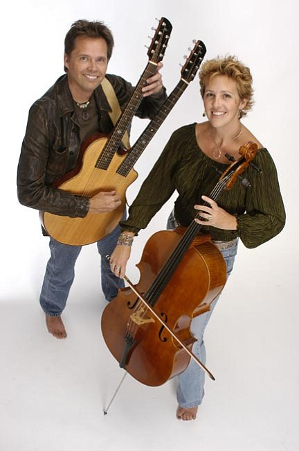 Acoustic Eidolon's Joe Scott and Hannah Alkire perform at Granite Peak Unitarian Universalist Hall Saturday.