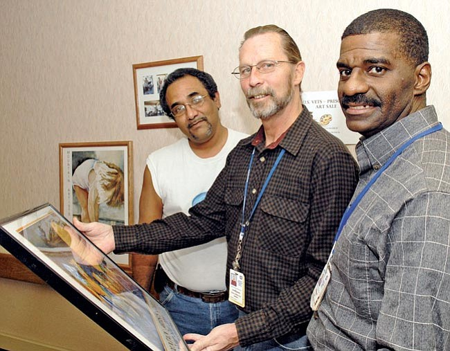 The Daily Courier/Jo. L. Keener<br> Formerly homeless veterans Daniel Tejada, George Henkel and Paul Pounds look at artwork for sale during a U.S. Vets open house Wednesday at the Bob Stump VA Medical Center in Prescott. The homeless vets stay at the VA center under a U.S. Vets program that helps with rehabilitation and gives the vets a new direction.
