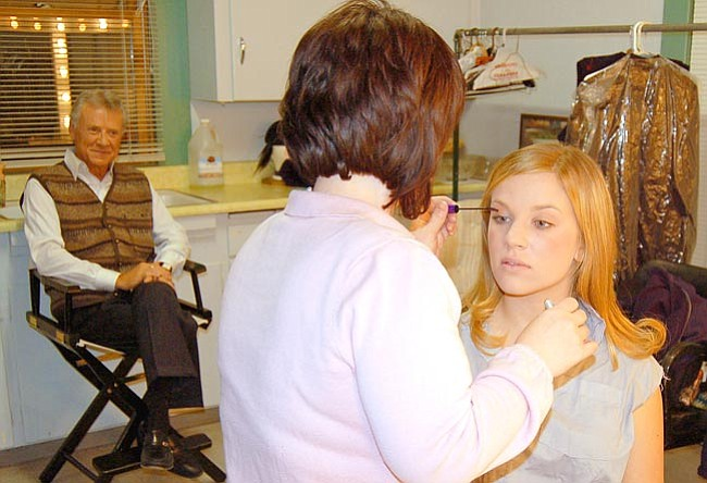 """The Scene/Lorin McLain<br> Layne Longfellow watches make-up artist Catherine Hinckley apply finishing touches to Briana Polland before the dress rehearsal of """"The Chidren's Hour."""""""