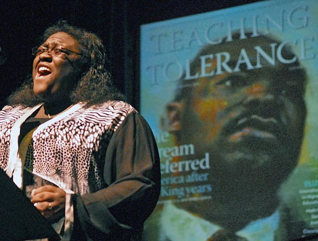 "The Daily Courier/Matt Hinshaw<br> Nicosia Garrison performs ""Lift Every Voice to Sing"" Monday night during the Celebrating the Legacy of Dr. Martin Luther King Jr. event at the Yavapai College Performance Hall."