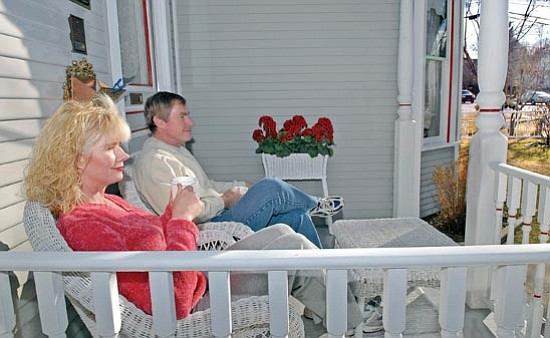 The Daily Courier/Jo. L. Keener<br> Linda and Ron Woodward enjoy afternoon tea on their Mt. Vernon Avenue front porch recently in Prescott.