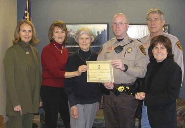 The Daily Courier/Joanne C. Twaddell<br> From left:  Lindy Cooper-Wisdom, Christy Cooper-Hastings, Janelle Cooper, Deputy Douglas Owens, Sheriff Steve Waugh and Jane Anne Shimizu. The Jeff Cooper Legacy Foundation gave Owens, who is Yavapai County deputy of the year, a five-day scholarship award to the Gunsite Academy in Paulden.