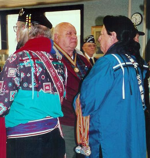 "Courtesy/Commander Alfonso Santillan Jr. <br> Richard Smith, center, a Korean War combat veteran stands at attention as he received a ""Warriors Medal of Valor"" from Larry Kimmel, left, (Miami Tribe of Indians of Indiana) and Ed Albert, right, (Cherokee Tribe) of the Arizona Territory Gourd Society."