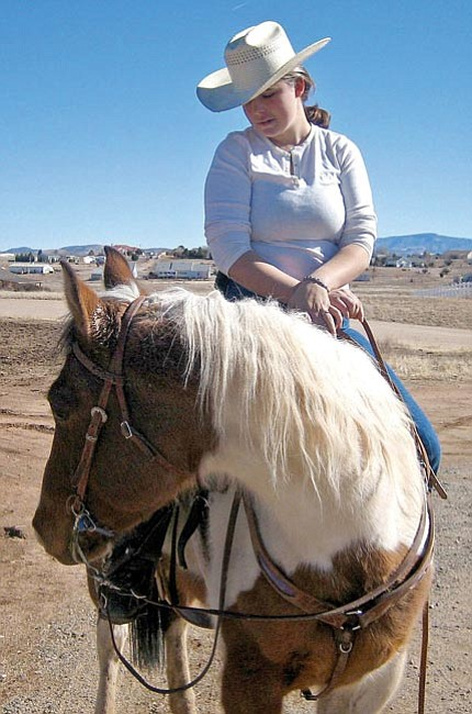 The Daily Courier/Derek Meurer<br> JoAnna Carrillo rides Mata, a horse she is training, at her Chino Valley home Jan. 31.