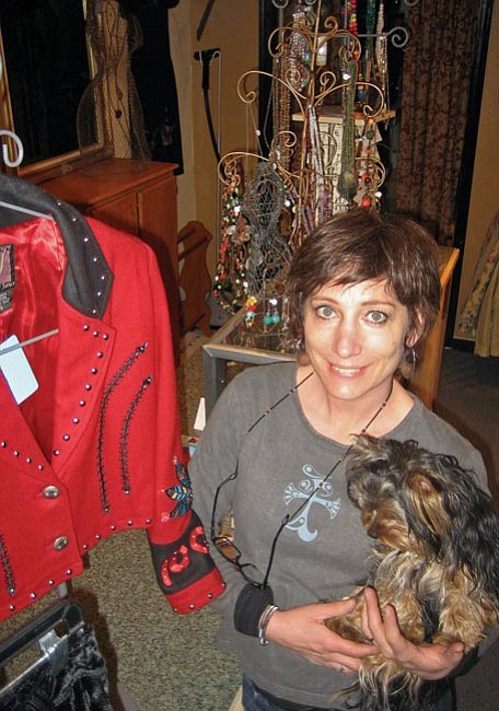 The Daily Courier/Jason Soifer<br> Di Hebgen, owner of Lucky You! Resale Clothing Boutique in Prescott, holds her Yorkshire terrier ChaCha.