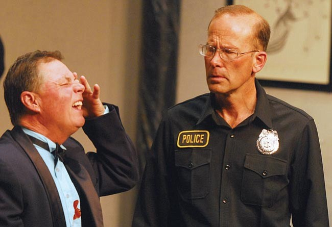 """The Scene/Matt Hinshaw<br> Officer Welch, played by Loring Snyder (right), talks to Glen Cooper, played by Michael Sollazzo, in a scene from the new PFAA play """"Rumors"""" Monday night in Prescott."""