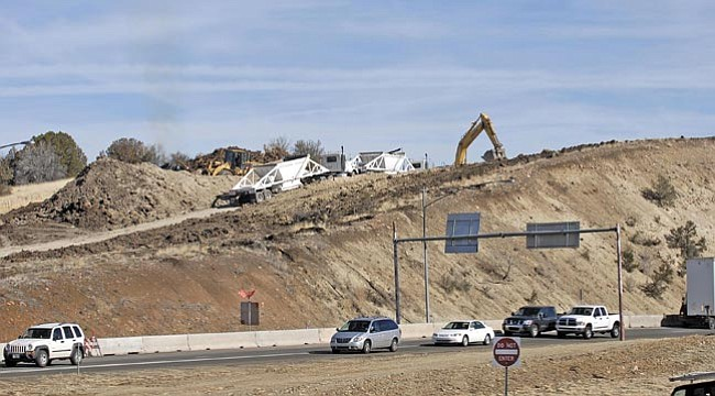 The Daily Courier/Jo. L. Keener<br> Heavy equipment removes earth next to Yavapai College as work continues to redesign the Highway 69 and 89 interchange.