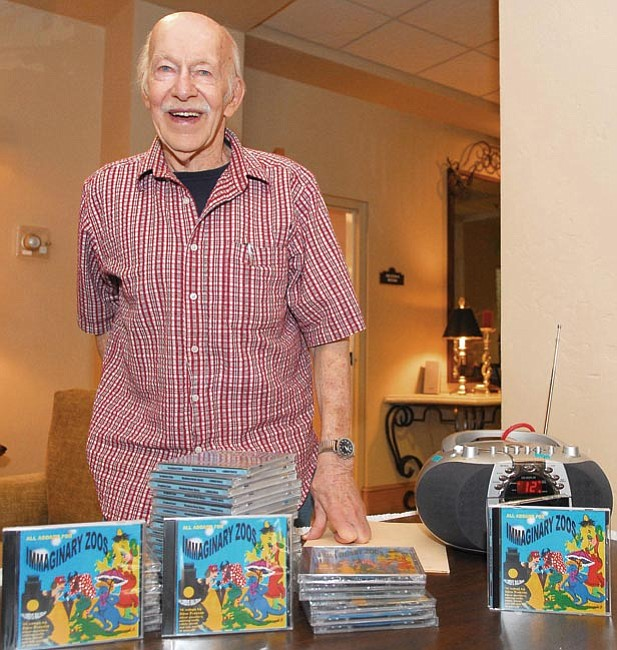 "The Daily Courier/Matt Hinshaw<br> Dave Preston stands inside the Granite Gate Senior Living Communities' lobby selling his latest children's music album ""Imaginary Zoos"" Friday afternoon in Prescott.  Preston has been creating songs for children for over 50 years."