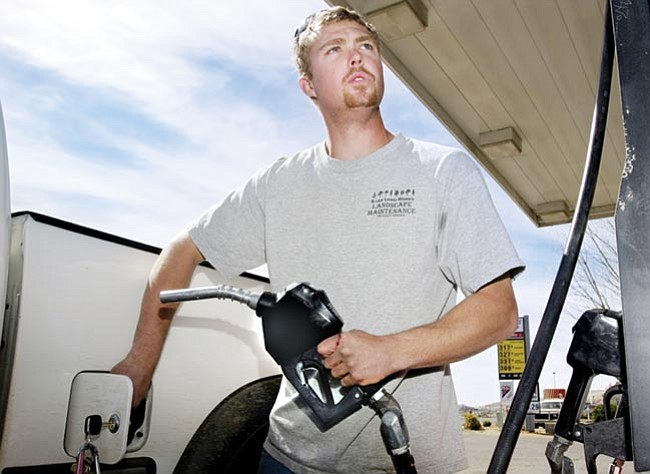 """The Daily Courier/Les Stukenberg<br> Shaun Hill, a landscaper from Prescott Valley, said """"so much money goes into my gas tank it's insane,"""" as he puts $50 into his truck's tank."""