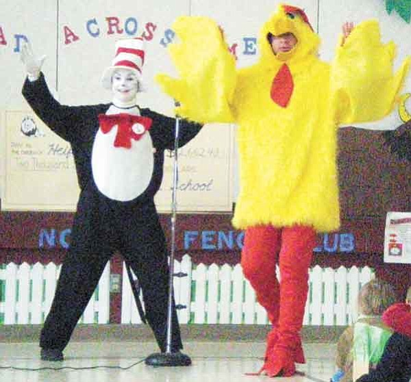 Courtesy<br> Lincoln School Principal Bucky Bates donned a chicken costume and danced with Cat in the Hat March 3 to honor a reading challenge to his students.
