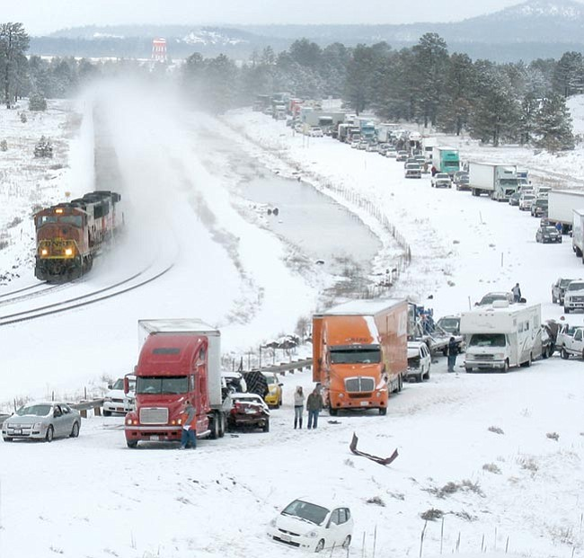 Courtesy/Steve Lutz<br> A Burlington Northern Santa Fe train runs on by the large multi-vehicle collision on Interstate 40 just west of Flagstaff Sunday afternoon.