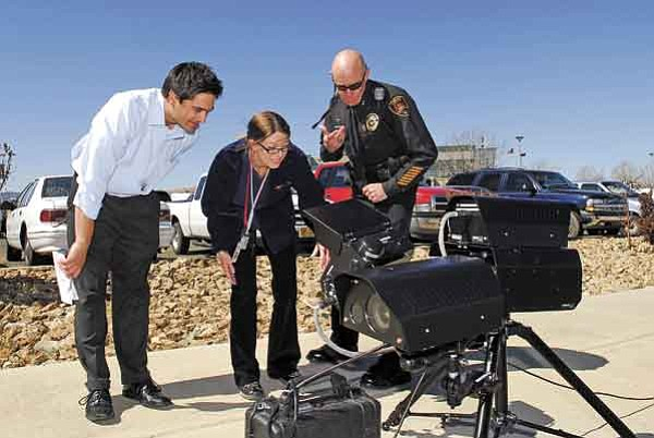 The Daily Courier/Jo. L. Keener<p> City officials watch a demonstration of Redflex's new photo enforcement system, which allows an operator to be a safe distance away from the roadway.