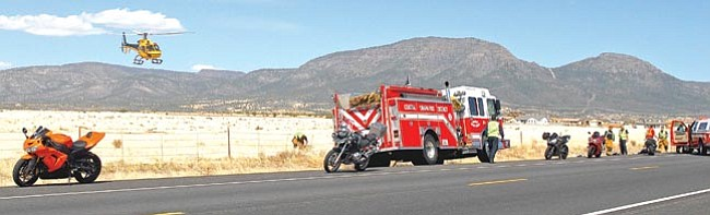 The Daily Courier/Matt Hinshaw<br> A medical helicopter lifts off the ground with a victim involved in a motorcycle accident on Highway 89A east of the Yavapai County Fairgrounds Sunday afternoon. Emergency personnel flew the victim to Phoenix for medical attention.