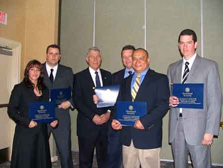 Courtesy<br> From left: Marissa Padilla,  Keith Chase, Sheriff Steve Waugh,  Brian Schultz, Alfredo Forbes and Brian Callaghan. Todd Swain was not present for the photo.