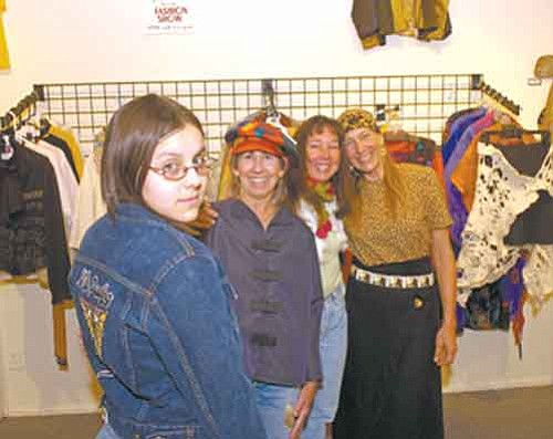 The Daily Courier/ Jo. L. Keener Wearing recycled clothing as an art form, Katy Blevins, Mary Kaye O'Neil, Michelle Johnson and Sherri Curtis display their creations Tuesday at Art Prescott gallery on Whiskey Row.