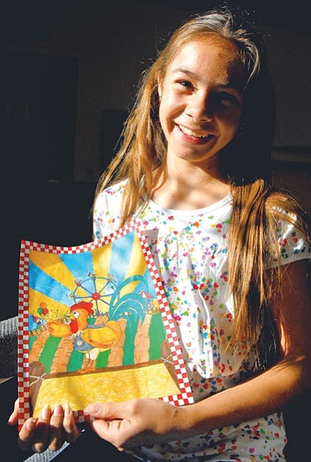 "The Daily Courier/Matt Hinshaw<p> Shalom Eis, 12, of Dewey displays her colored pencil and marker drawing she submitted in the contest for the Yavapai County Fair Premium Book Tuesday afternoon in Prescott Valley. There were more than 250 entries this year for the theme ""Something to Crow About,"" but Shalom's entry took first in the contest."