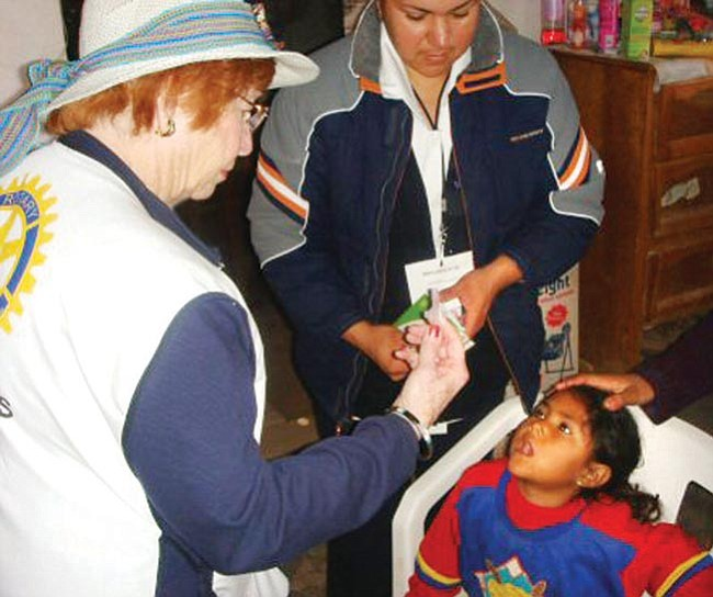 Courtesy <br>  Rotary Club members administer polio vaccines to children in Caborca, Mexico – Prescott's sister city.