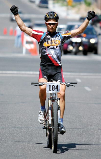 Courtesy/Dusty Hiles<p> Riders in this year's Whiskey Off-Road mountain biking race on Saturday honored the memory of professional cyclist Mike Janelle, shown here crossing the finish line as the Men's Open Class winner of the 2007 Whiskey Off-Road in downtown Prescott.
