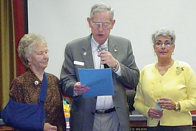 """Courtesy<br> City of Prescott Mayor Jack D. Wilson reads a proclamation to Anne Lack, President of GFWC The Monday Club, Inc. and June Nash, member of the club. The mayor proclaimed April 24 as """"GFWC Federation Day."""""""