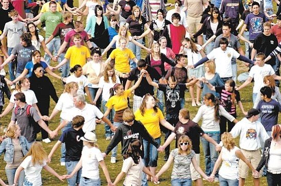 The Daily Courier/ Jo. L. Keener<p> Students and staff of Prescott High School attempt to break the Guinness World Record for the Longest Breakdance Hand Wave Tuesday on Bill Shepherd field in  Prescott.