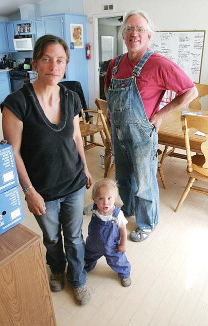The Daily Courier/Les Stukenberg<br> Cory, Shanti and young Cooper Rade at their Paulden farm talk about the upcoming Cystic Fibrosis walk.