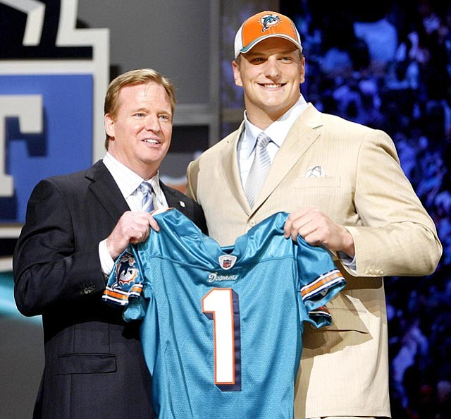 The Associated Press/Jason DeCrow<br>Former Michigan tackle Jake Long, right, pictured on draft day with NFL Commissioner Roger Goodell last month, signed a five-year, $57.5 million deal with Miami.