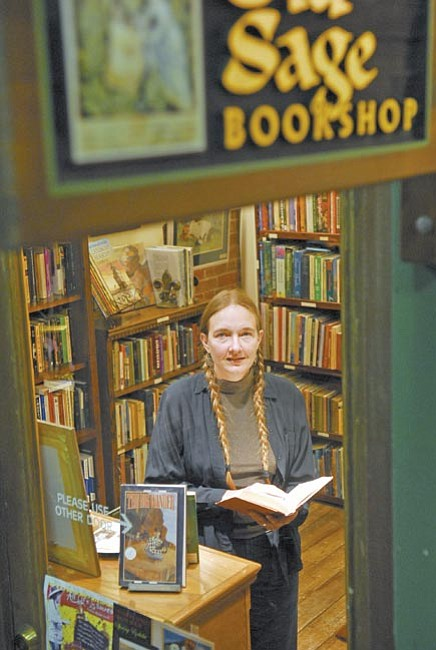 The Daily Courier/Jo. L. Keener<br> Susan McElheran stands at the front of the Old Sage Bookshop in the St. Michael's Court in Prescott Tuesday morning. The shop has been open since December.