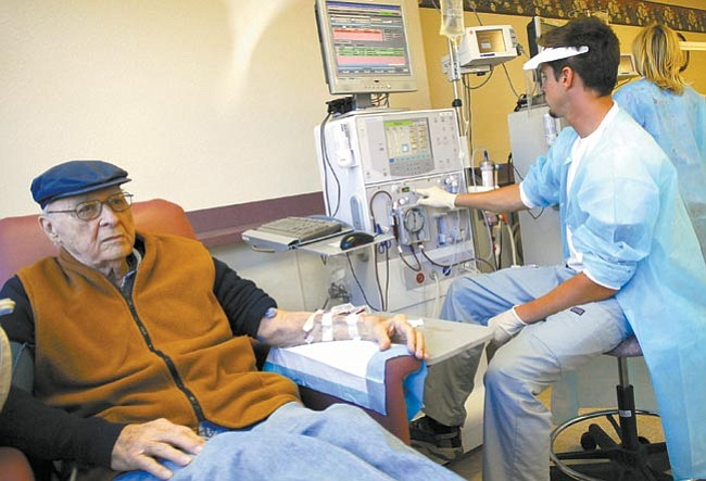 The Daily Courier/Jo. L. Keener<br> Dan Nichols is connected to a dialysis machine Thursday morning by technician Joel Floyd as Nichols starts his treatment.