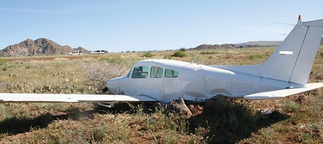 Courtesy/Yavapai County Sheriff's Office<br> This Beech aircraft crashed Saturday evening 100 yards south of the Bagdad runway. The Civil Air Patrol located the deserted crash site Sunday morning.