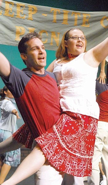 "The Scene/Matt Hinshaw<p> Anderson (Brian Biggs) and Sandra (Sarah Elliott) dance and sing during Monday night's dress rehearsal of ""The Pajama Game."""
