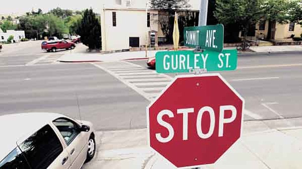 The Daily Courier/Jo. L. Keener The crosswalk at Gurley and Summit streets is a challenge for pedestrians because of the wide street and volume of traffic. A petition is circulating seeking a traffic signal for the intersection.