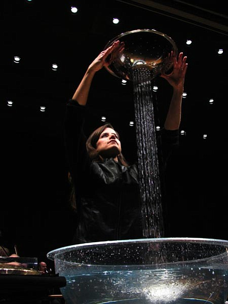 Courtesy<br> Maria Flurry plays water percussion during a performance with the Spokane Symphony Orchestra.