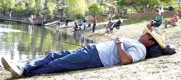 The Daily Courier/ File<br> Bobo Castaneda takes a break from fishing and catches some Zs during the Free Fishing Day on the south shore of Lynx Lake in Prescott June 9, 2007.