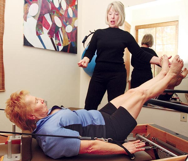 The Daily Courier/Les Stukenberg<br> Zenda Sergo works with client Patricia Bruneau-Gaber at the Prescott Pilates Studio. Sergo moved to Prescott from Chicago about four years ago where she was a broker on the Chicago Board of Trade.