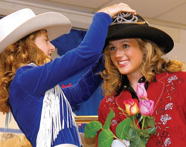 The Daily Courier/Matt Hinshaw<br> 2008 Prescott Frontier Days Worlds Oldest Rodeo Junior Court Queen Emily Stevens, left, crowns Jordan Anderson as the 2009 queen Sunday afternoon at the Prescott Rodeo Grounds.