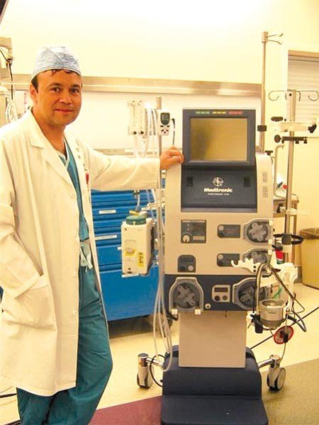 Courtesy<br> Dr. Peter Tibi, director of Yavapai Regional Medical Center's cardiothoracic surgery, shows off a Medtronic pump – a state-of-the-art heart/lung bypass machine that helps preserve a patient's blood during surgery with less trauma so more of it can be reused.
