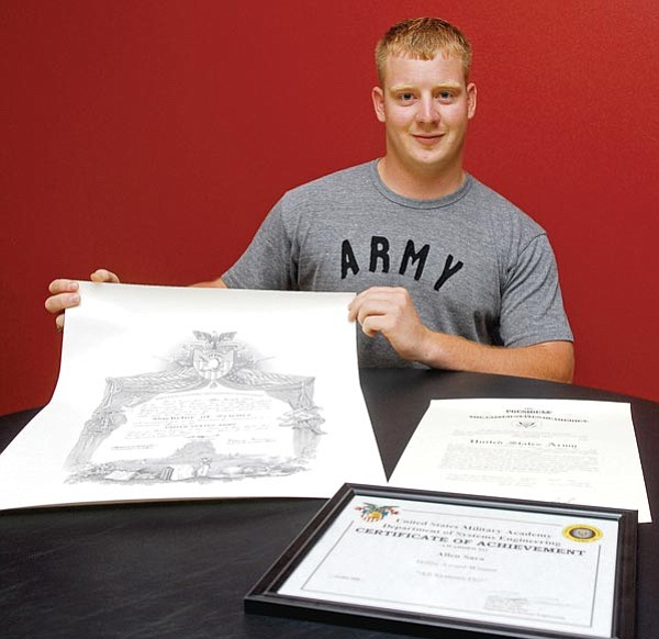 The Daily Courier/Matt Hinshaw<br> West Point graduate Allen Sara displays his diploma in engineering management, his commission into the U.S. Army as a second lieutenant, and an engineering award he received for a senior project at his home in this past Monday afternoon in Williamson Valley.  Sara will be heading to Ft. Benning, Ga., to begin a 12-month officer-training school.