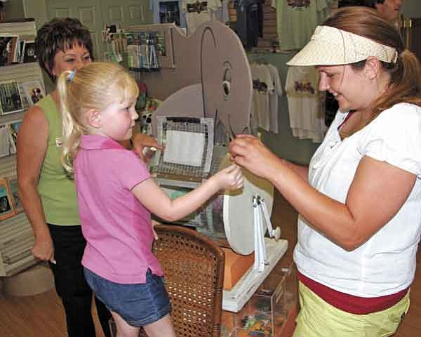 Courtesy photo/Heritage Park Zoological Sanctuary<p> Four-year-old Madelyn Luttrell of Spokane, Wash., hands the winning raffle ticket to Heritage Park Zoological Sanctuary events coordinator Jennifer Woolnought June 30, while executive director Pat McLaren watches the proceedings.